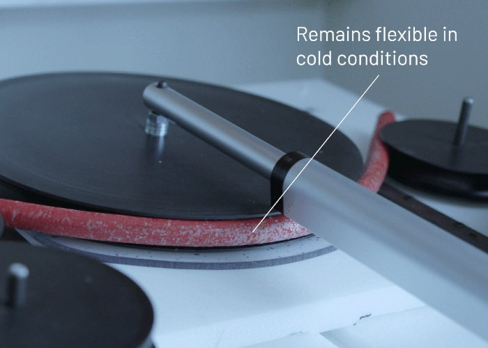 EV cable during bend test in cold chamber with text: Remains flexible in cold conditions.